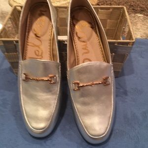 Never been worn silver flats with gold trim